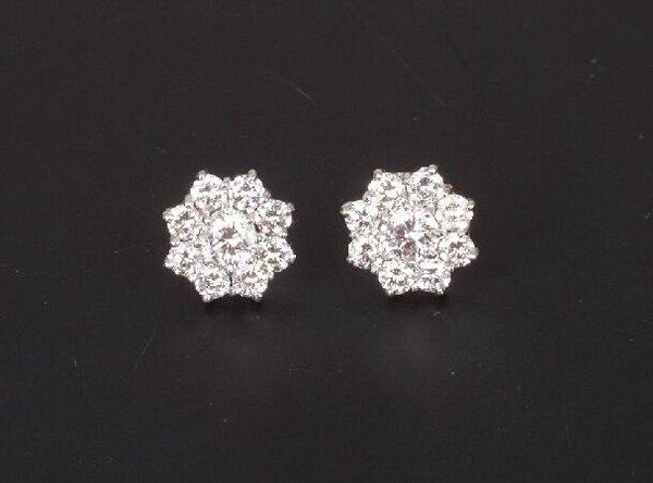 3: A pair of 18ct white gold nine stone diamo