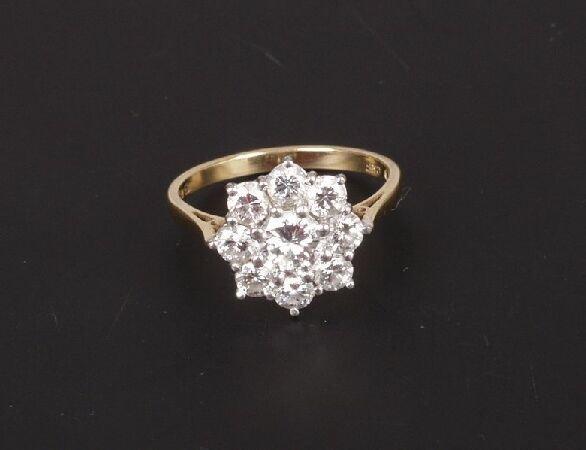 4: 18ct gold mounted nine stone diamond circu
