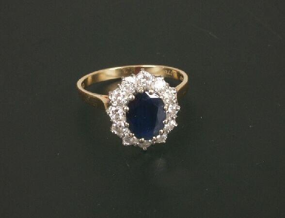 6: 18ct gold oval sapphire and diamond thirte
