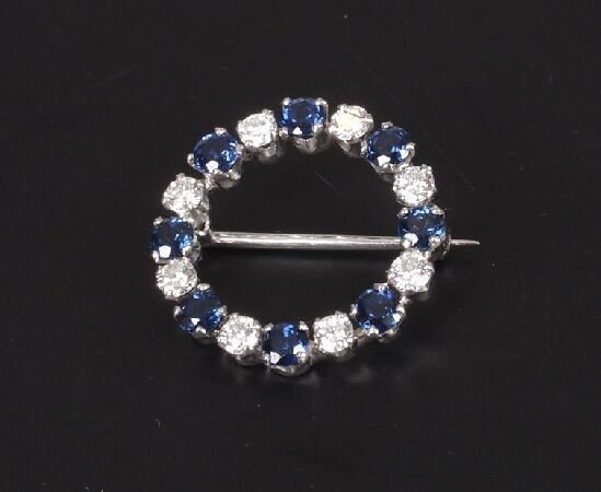 10: A sapphire and diamond wreath brooch with