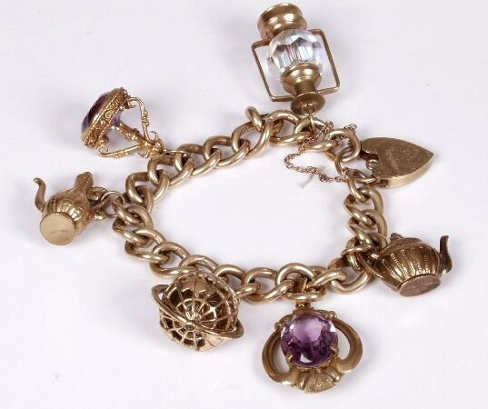 18: 9ct gold curb link bracelet with six char