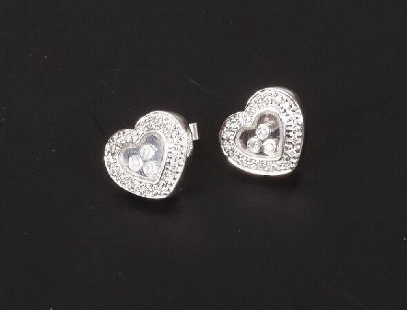 47: A pair of heart shape earstuds with a dia