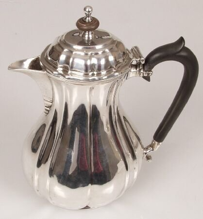 1003: Late Victorian hot water pot, of lobed