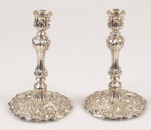 1010: Pair of late Victorian tapersticks, of