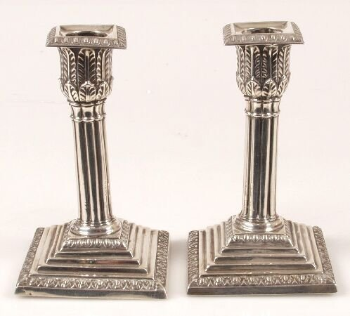 1011: Pair of late Victorian candlesticks, of