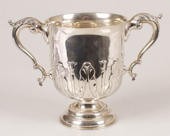 1018: Edwardian twin handled cup, with stiff