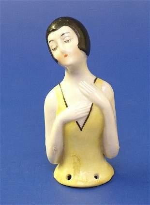 2: A porcelain half doll, modelled as a lady