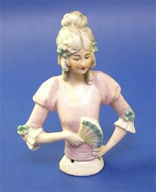 4: A porcelain half doll modelled as a lady i
