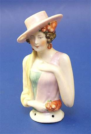 5: A porcelain half doll modelled as a lady w