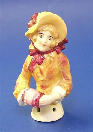 6: A ceramic half doll modelled as a young la