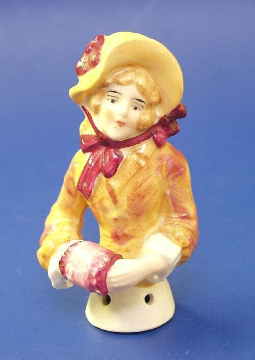 6: A ceramic half doll modelled as a young la