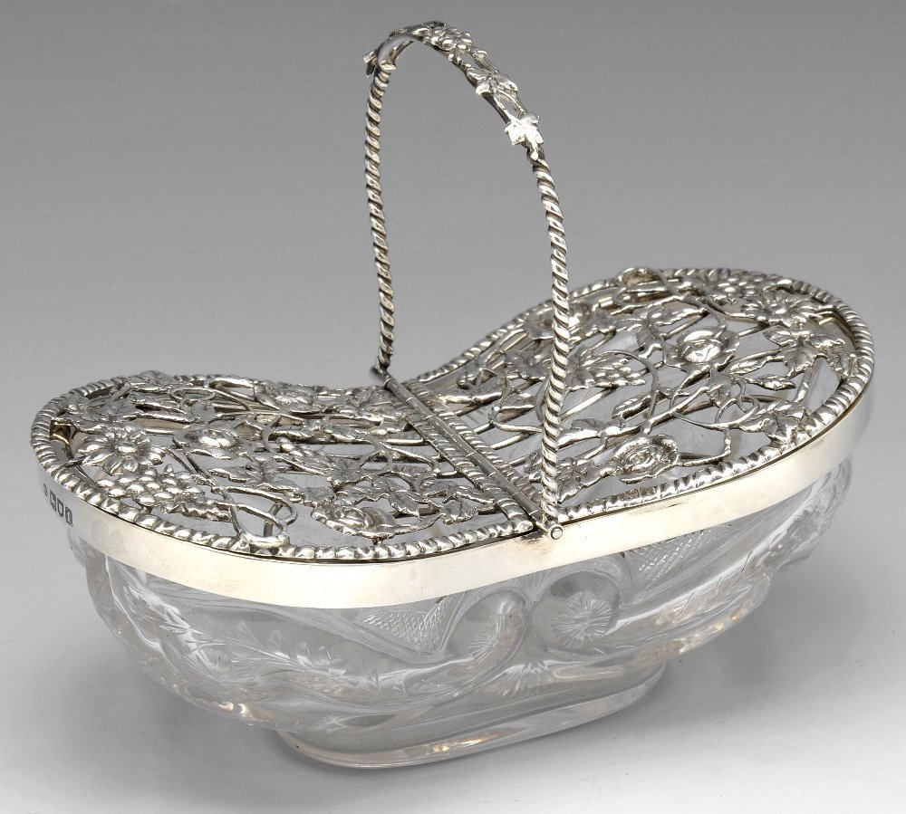 An Edwardian silver mounted glass pot pourri basket by