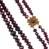 A late Victorian garnet tworow necklace with gold