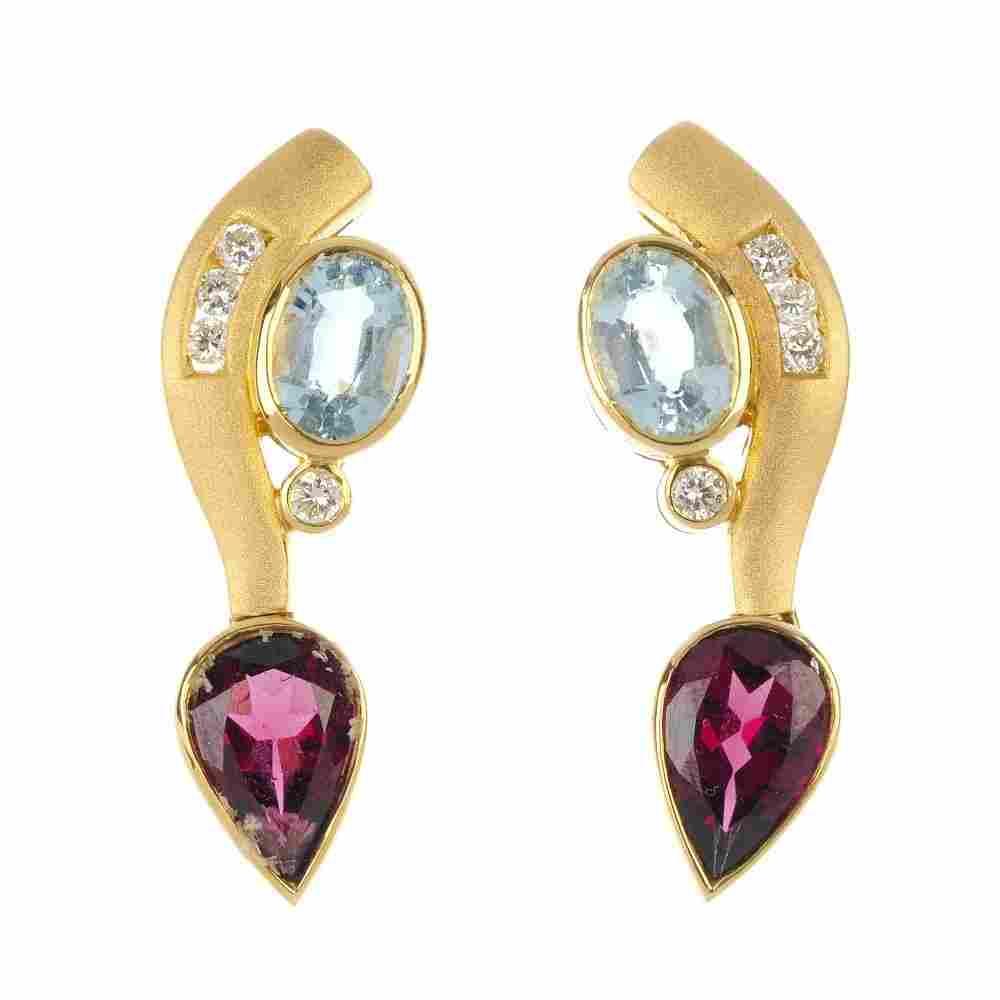 A pair of 18ct gold aquamarine and garnet earrings.