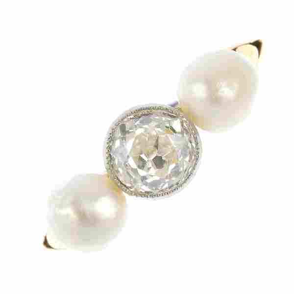 A natural saltwater pearl and diamond three-stone ring.