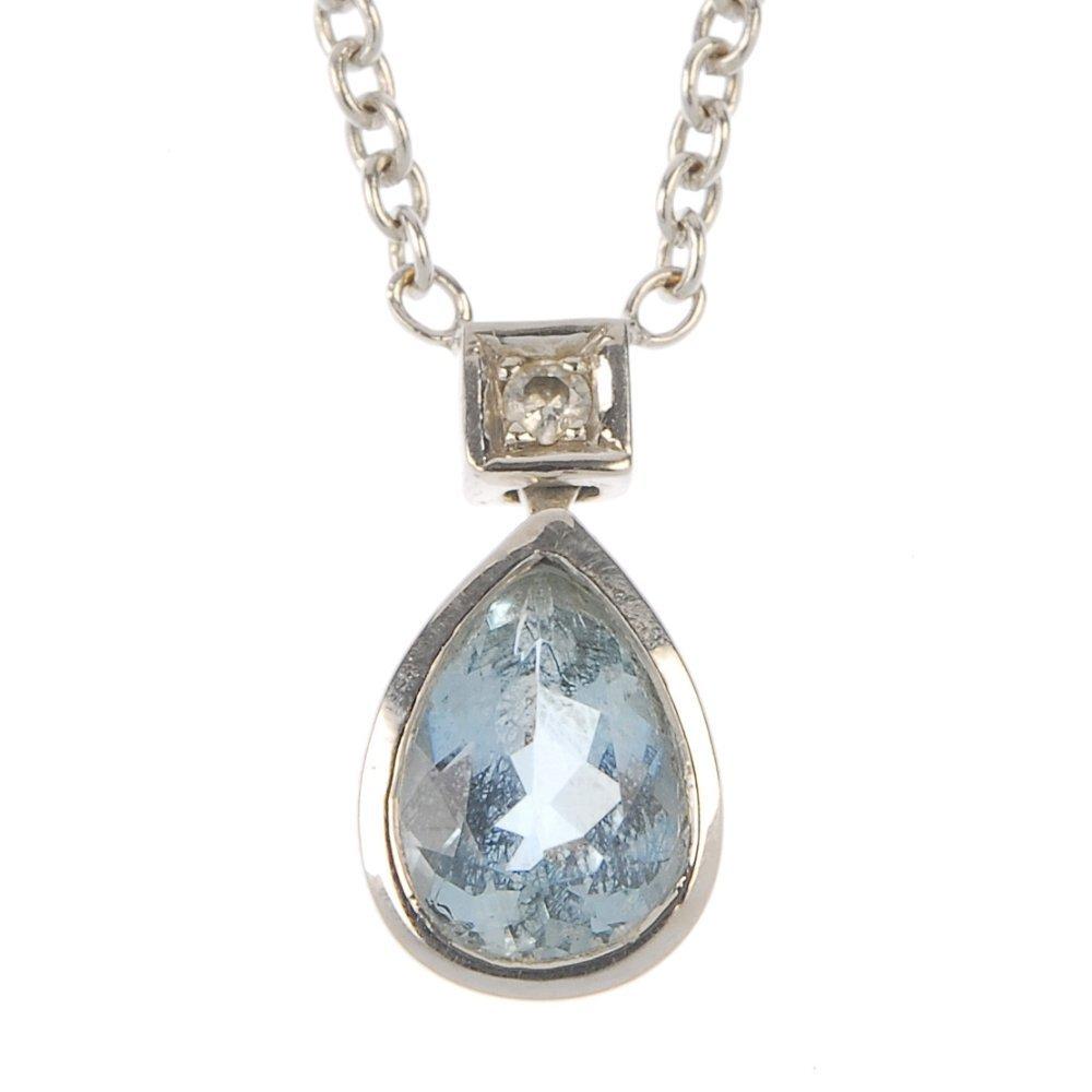 A set of aquamarine and diamond jewellery.