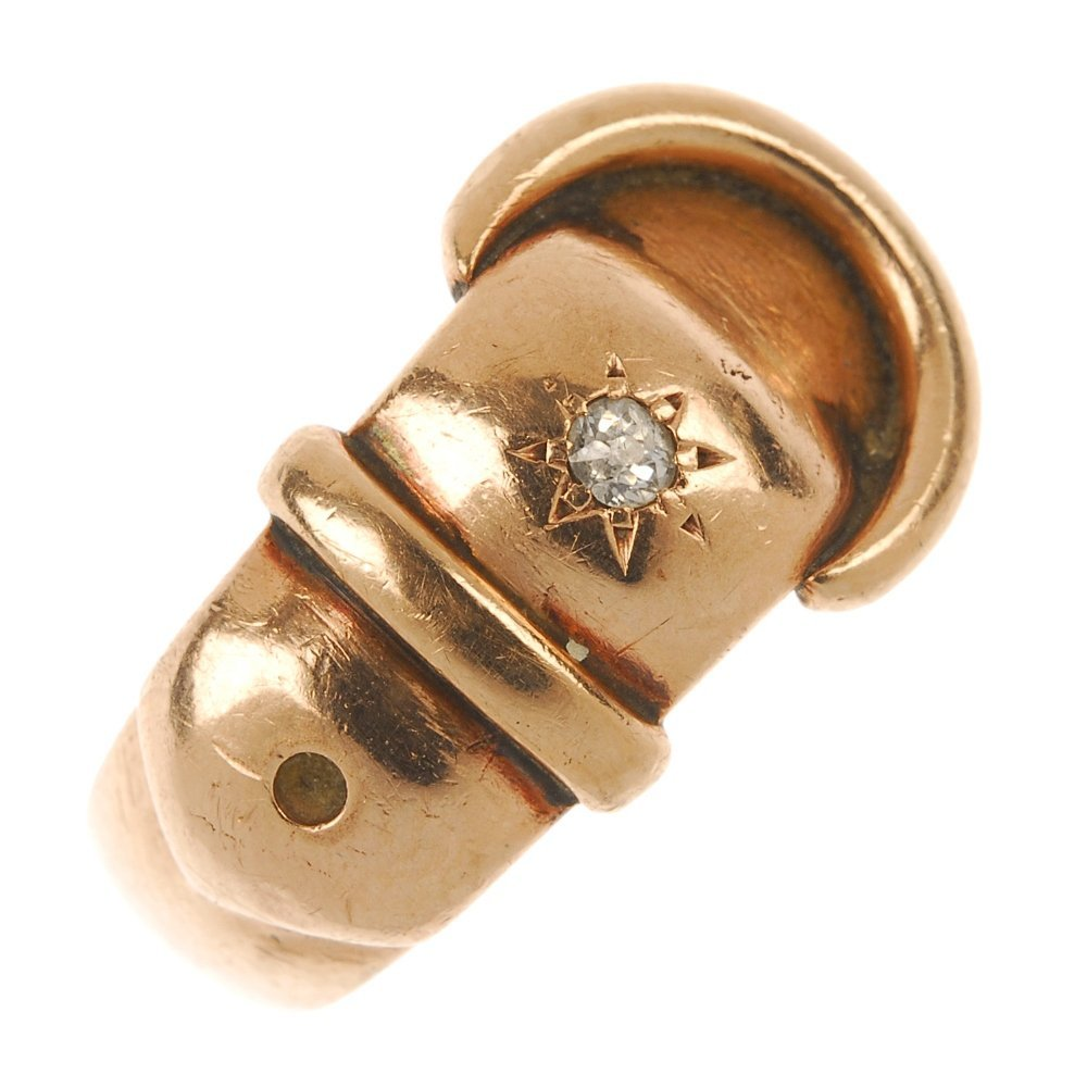 An Edwardian 9ct gold diamond accent buckle ring.