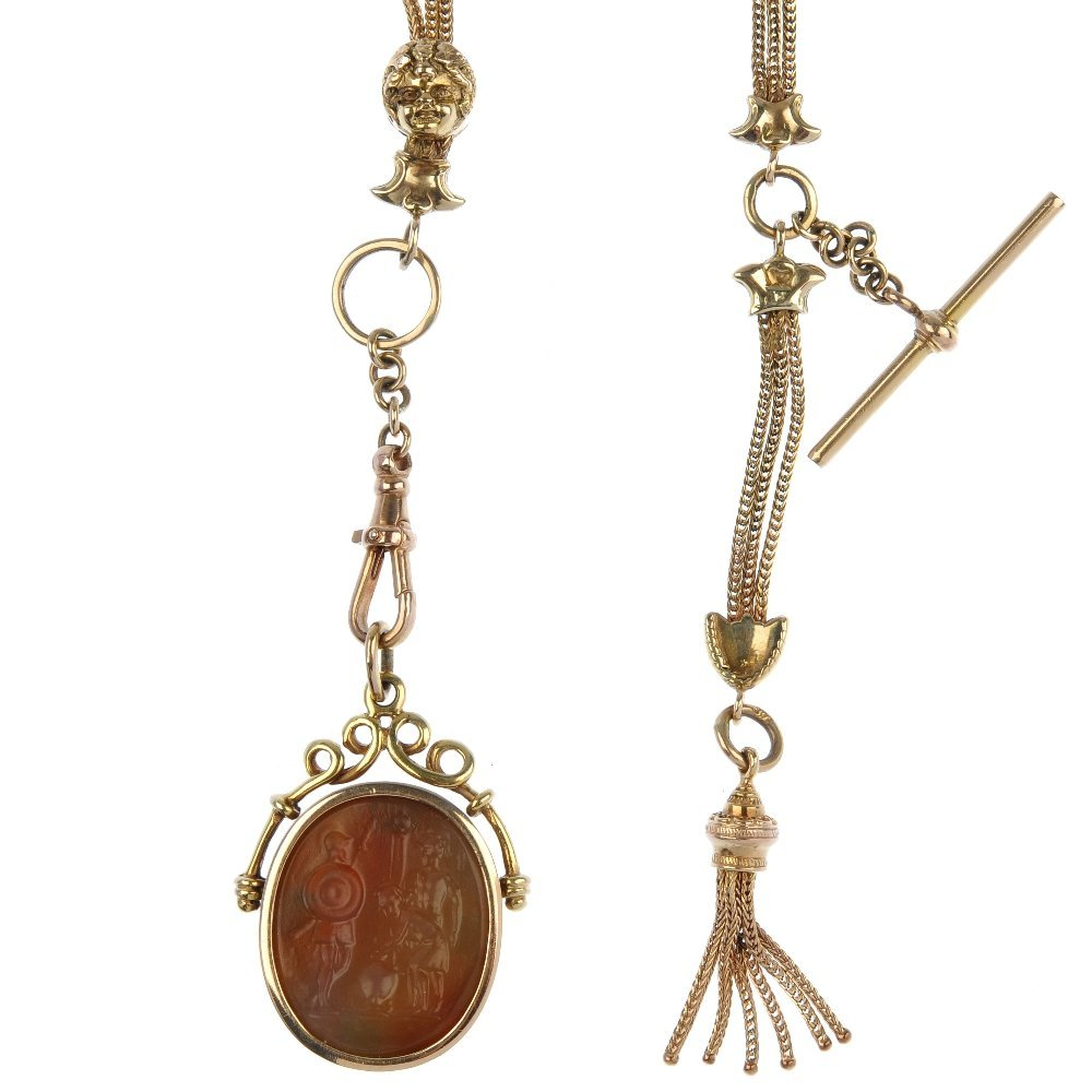 A carnelian intaglio pendant and Albert chain.