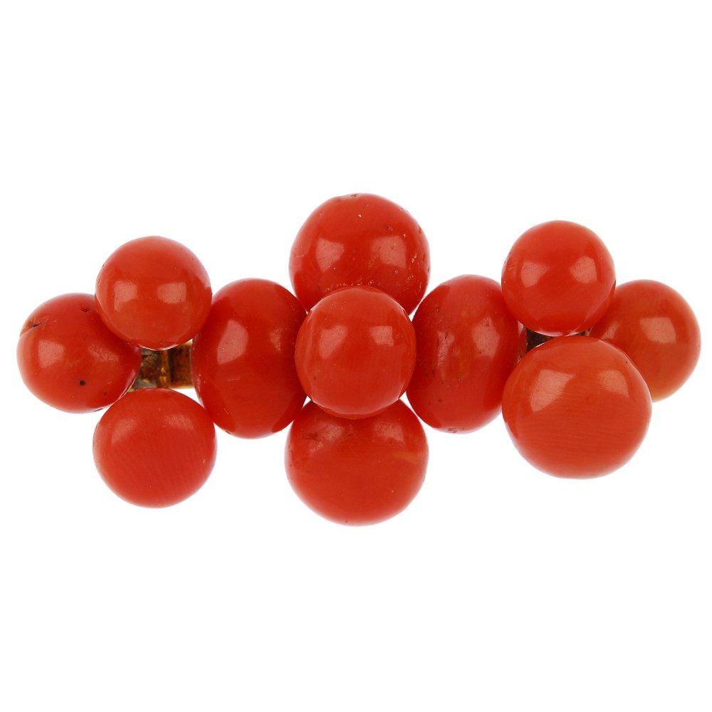 Five items of coral jewellery, to include two brooches,