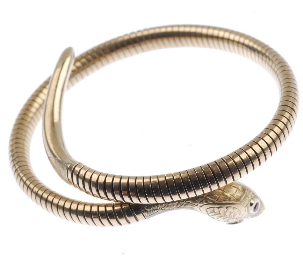 A mid 20th century 9ct gold snake bangle. - 2