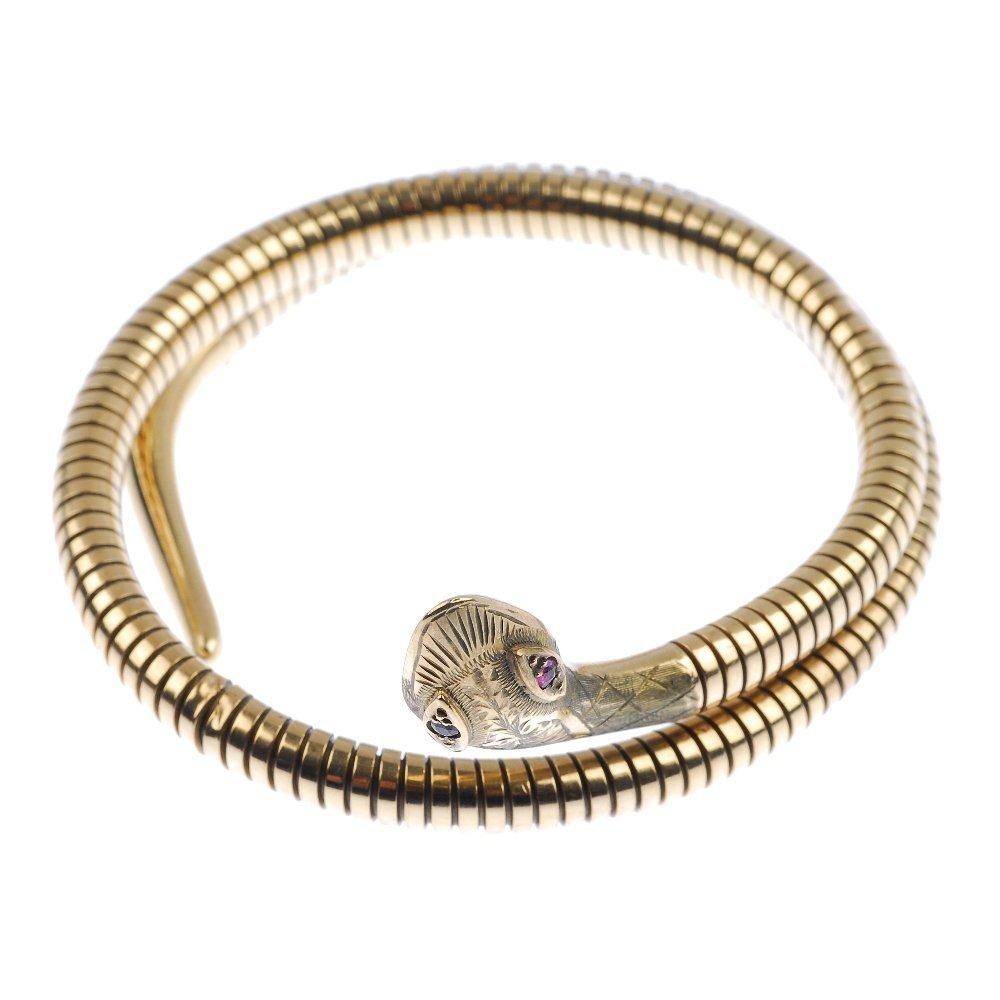 A 9ct gold snake bangle.