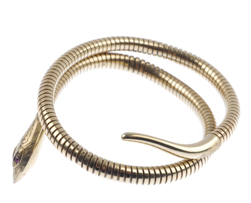 A 9ct gold snake bangle. - 3