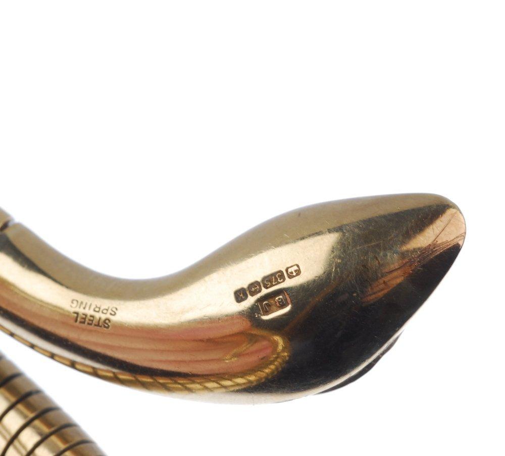 A 9ct gold snake bangle. - 4