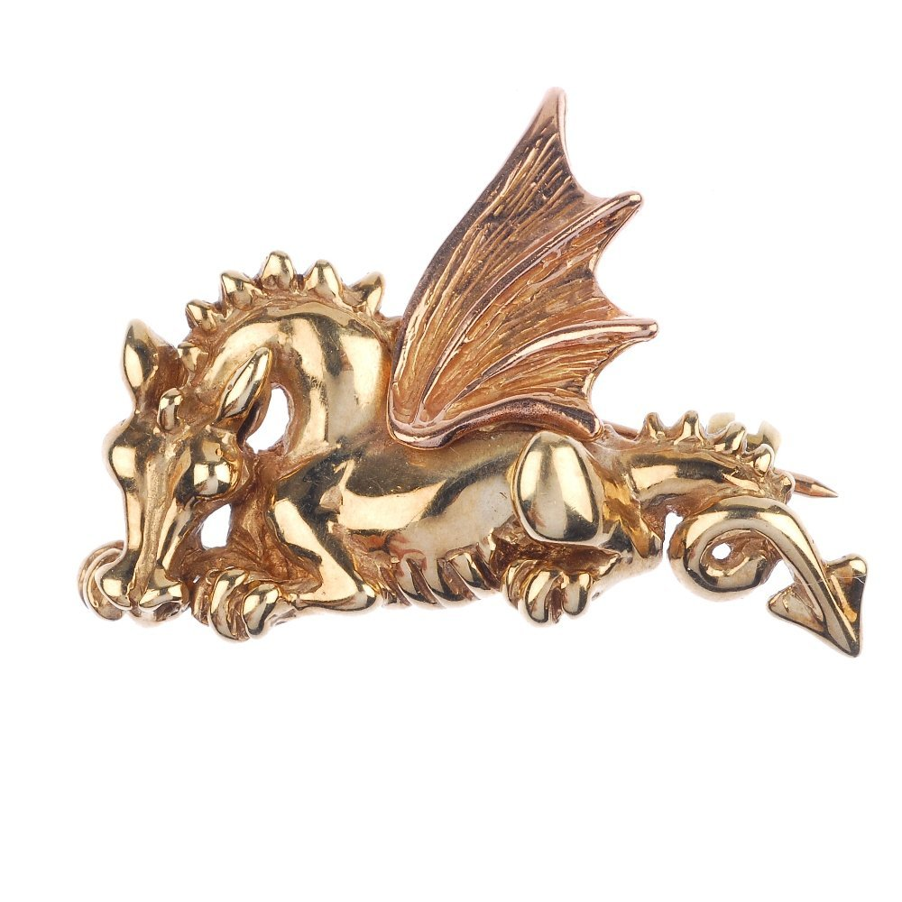 CLOGAU - a 9ct gold Welsh dragon brooch.