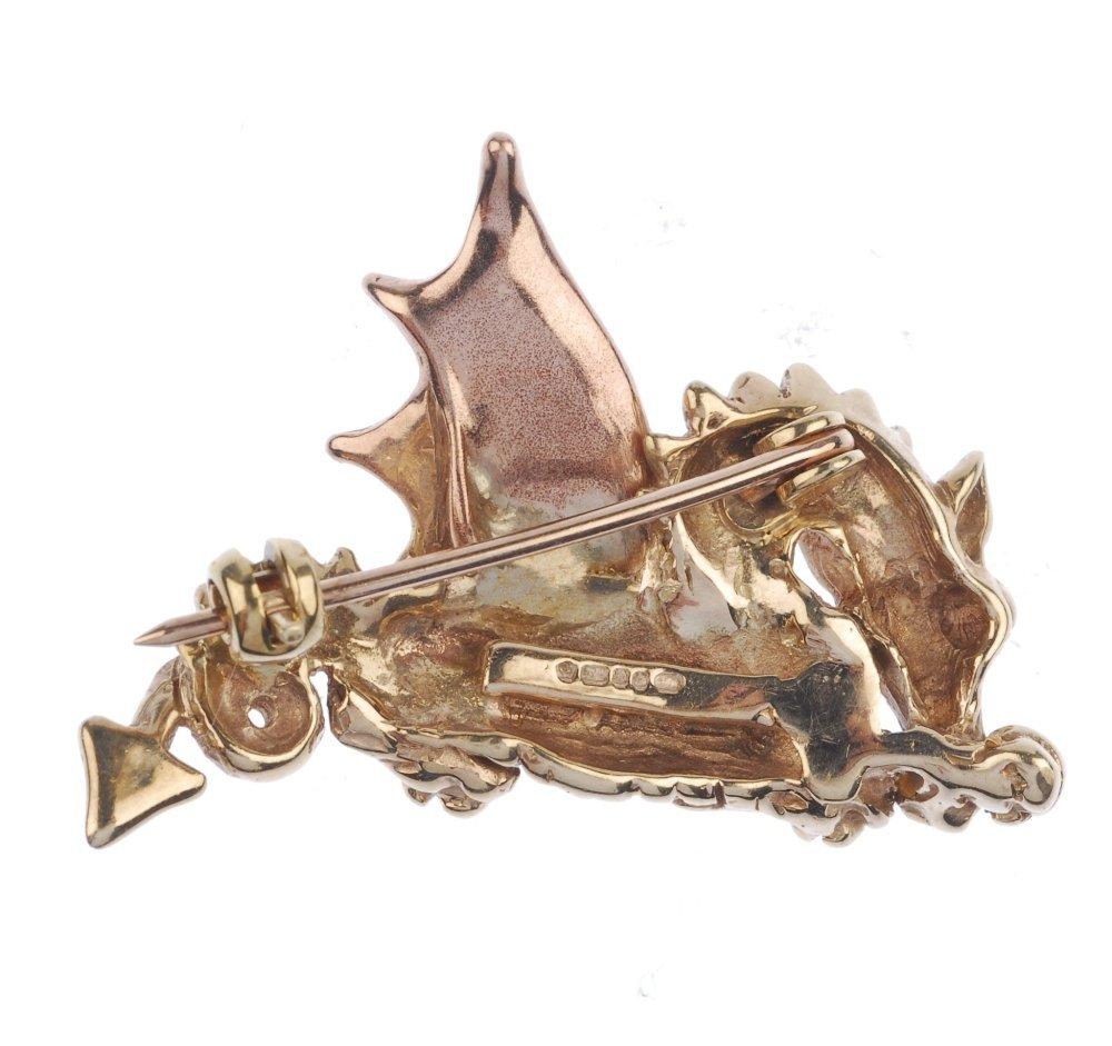 CLOGAU - a 9ct gold Welsh dragon brooch. - 2