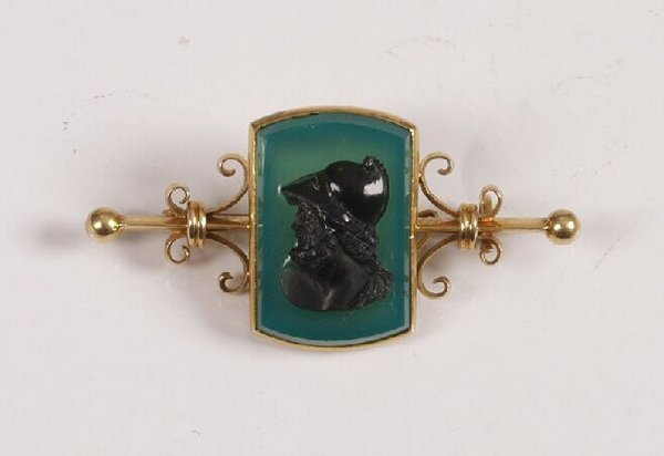 2: A dyed hardstone cameo bar brooch depicting a centur