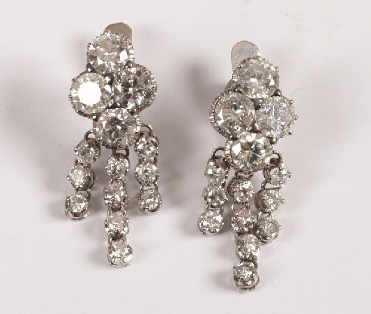 6: A pair of diamond dropper earrings in excess of 6.00