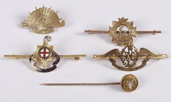 8: Four 9ct gold military bar brooches and a single dia