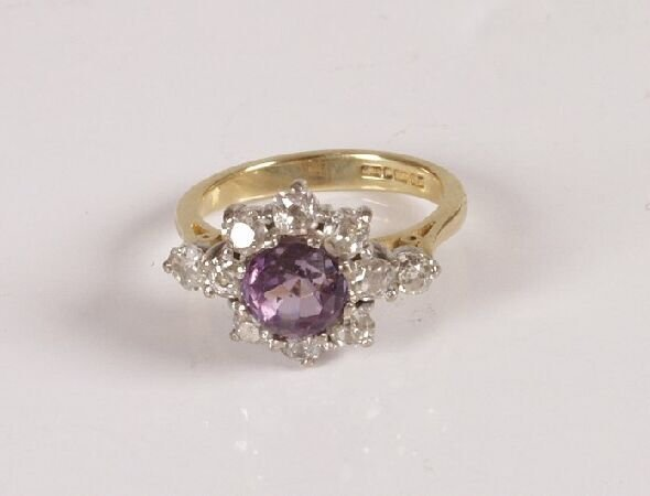 17: 18ct gold amethyst and diamond cluster ring with a