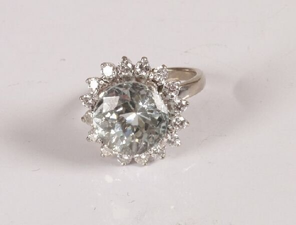 20: White metal very pale aquamarine and diamond cluste