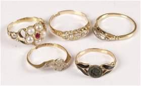 763: Three 18ct gold diamond set rings, a pearl and rub