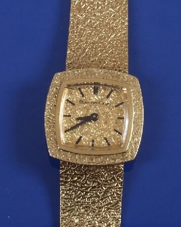 1015: BUECHE-GIROD-Lady's 18ct gold wrist watch with a