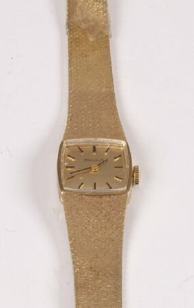 1022: BULOVA - a ladies 9ct yellow gold wristlet with c