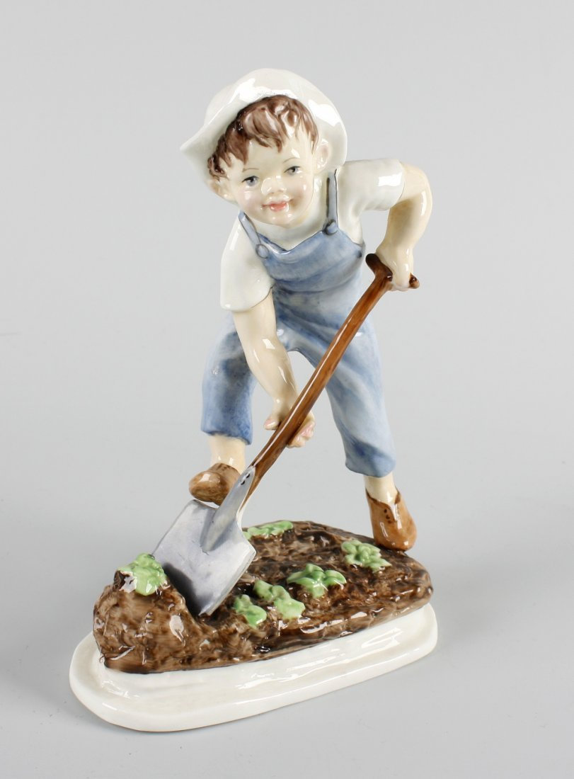 A Royal Worcester figure, 'Saturday's child works hard