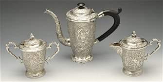 An Indian white metal three piece tea set