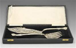A pair of Victorian silver fish servers etc