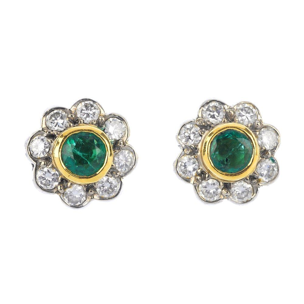 A pair of 18ct gold emerald and diamond floral cluster