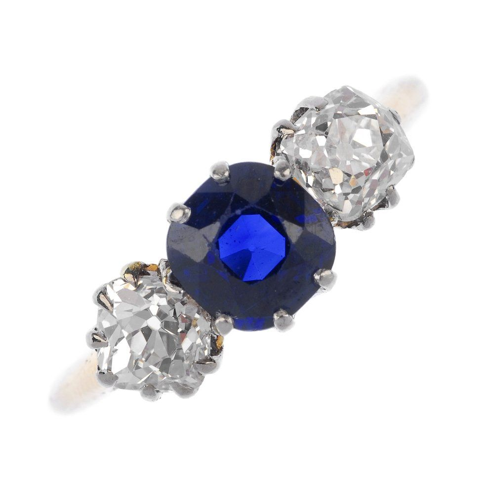 An Edwardian 18ct gold sapphire and diamond three-stone