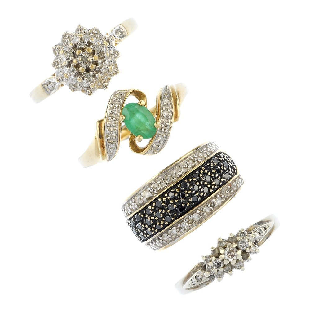 A selection of four 9ct gold diamond and gem-set rings.