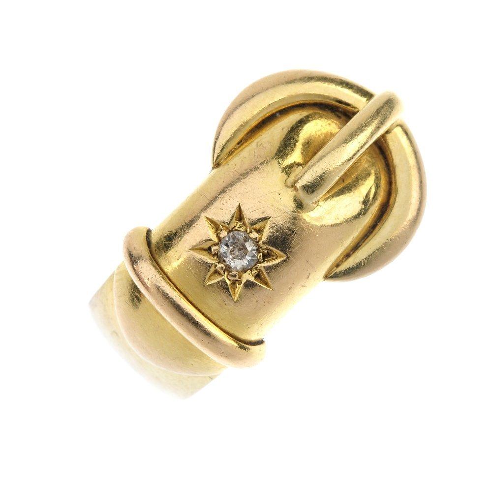 An Edwardian 18ct gold diamond buckle ring.