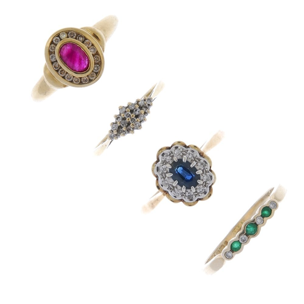 A selection of four gem-set dress rings.