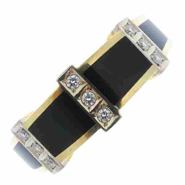 An onyx and diamond ring.