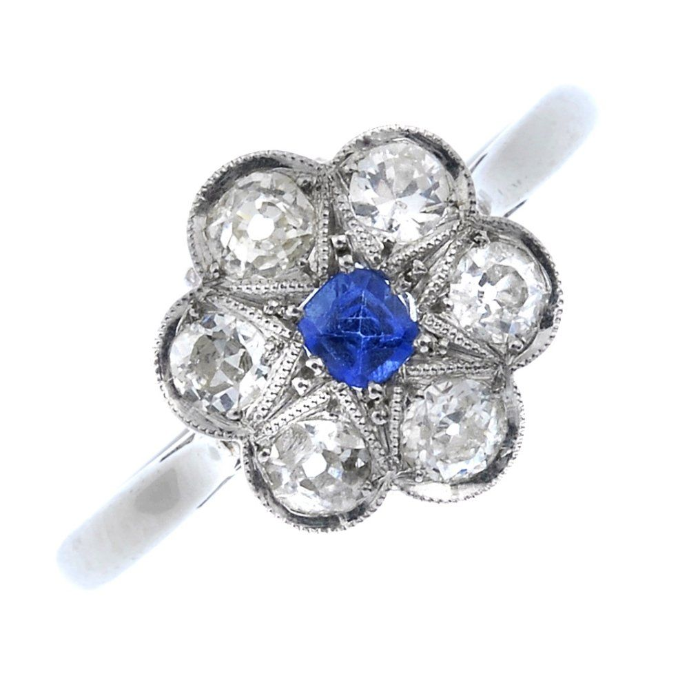 An 18ct gold and platinum sapphire and diamond floral