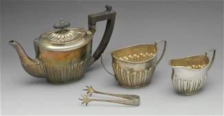 A late Victorian silver three piece bachelor tea