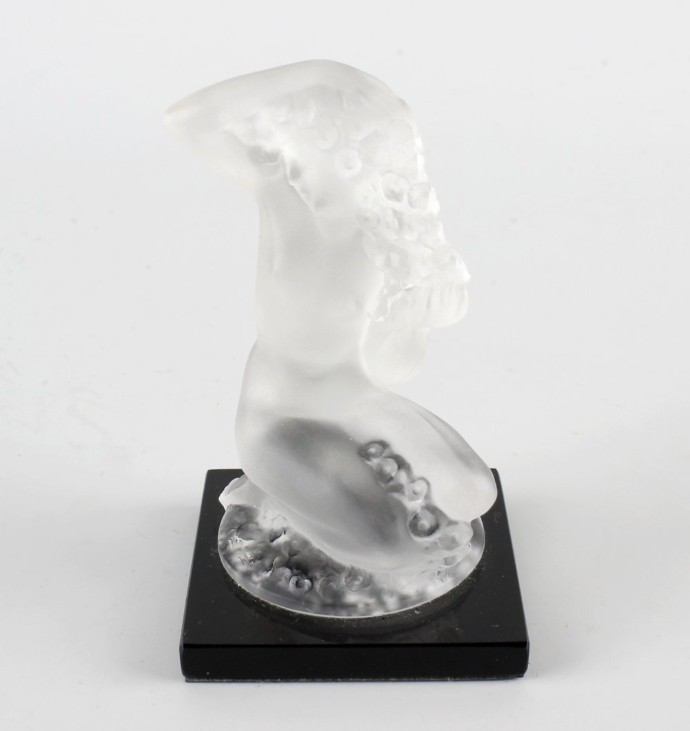 A modern frosted glass figure.