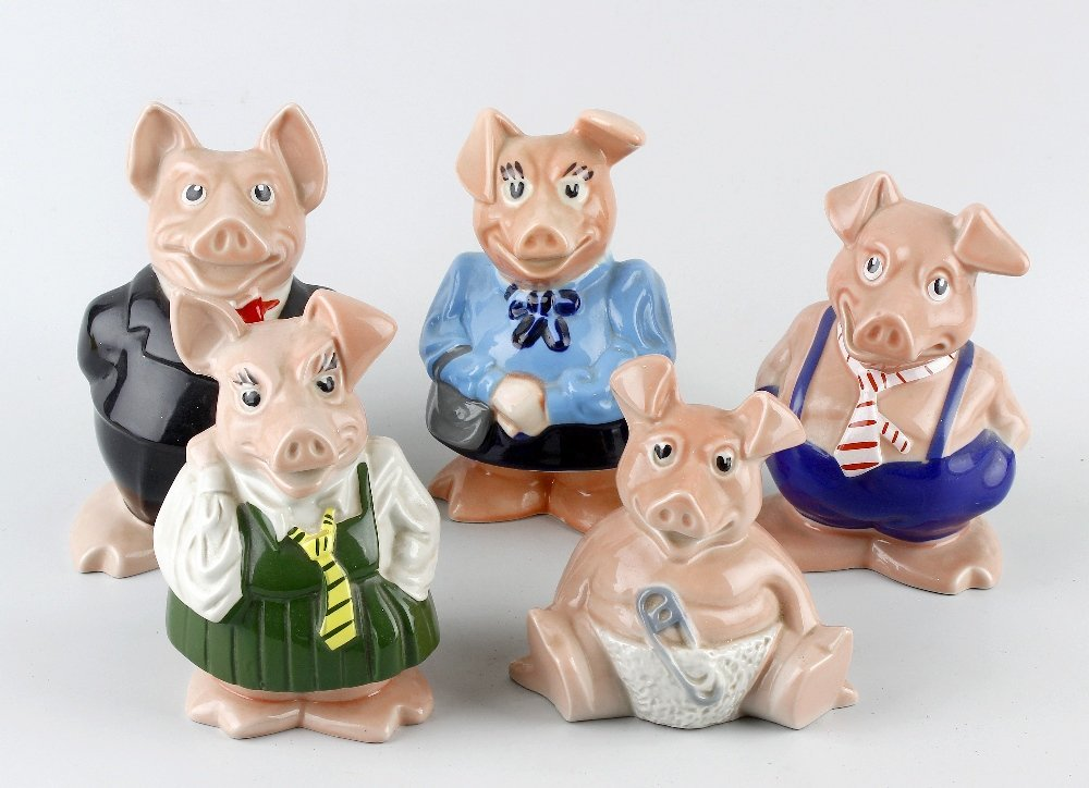 A box containing a set of five Wade Natwest piggy banks